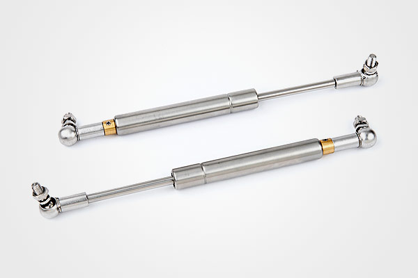Adjustable force gas springs